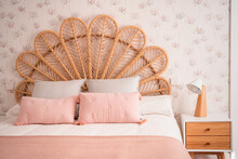 Comfortable Cute Natural Vintage Rattan Headboard Bed With Ornamental Cushions In A Room