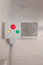 Close Up Of Nurse Call System With Emergency Buttons Installed Near Bed In Medical Room In Hospital