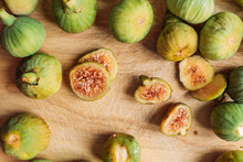Ripe Sweet Green Figs, Freshly Harvested From Domestic Tree On Wood Cutting Board. Also Known As Ripe White Figs