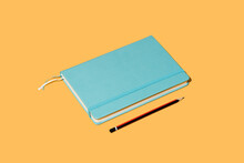 Vector Illustration Of Notepad Bookmark And Pencil For Taking Notes On Bright Orange Background