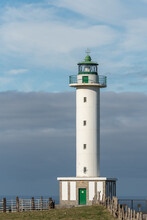 White Lighthouse Placed In Faro De Lastres In Asturias In Spain Under Cloudless Blue Sky In Daytime