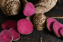 Overhead Composition Of Organic Natural Beetroot Cut Into Slices And Arranged On Shabby Wooden Surface