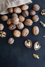 From Above Bag With Whole And Halved Walnuts With Dry Nutshells And Heart Shaped Center On Table