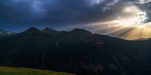 Spectacular Landscape Of Pyrenees Range Of Aran Valley With Sunbeams Shining Through Dense Stormy Clouds