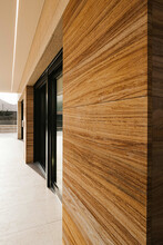 Modern Building Facade With Rectangular Shaped Ornament On Wooden Wall