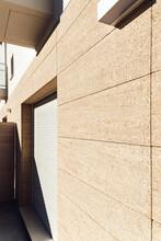 Contemporary Masonry Building Exterior With Shade On Wall On Sunny Day