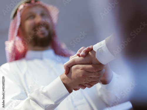 Fényképezés Business meeting with arab man and shaking each other hands in greetings and int