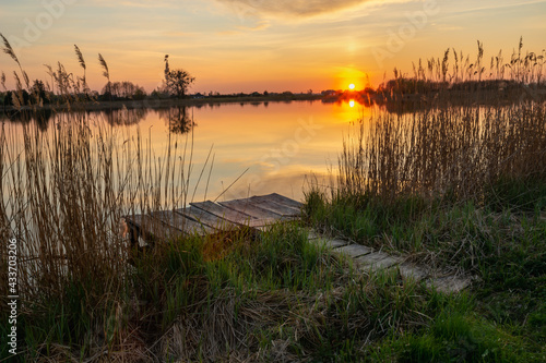 Tela Fishing pier on the shore of the lake and sunset, Stankow, Poland