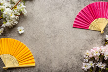 Asian Background With Hand Fans And Blossom Branches