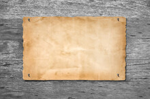 Old Grunge Empty Paper For Information Bulletin Board Was Fastened With Nails On Gray Wood Or Wooden Wall Background