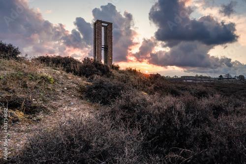 Obraz na płótnie Remains of world war 2 tower at dramatic sunset