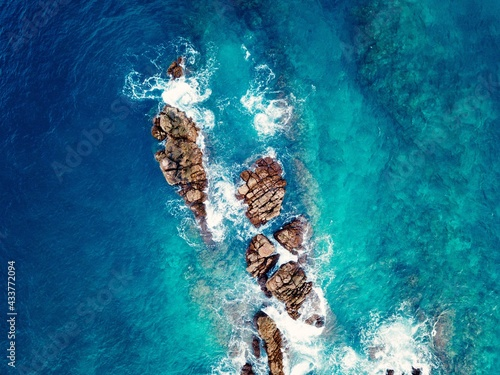 Top view aerial photo from flying drone of a little green, tropical island in open sea Fototapet