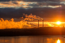Sunset On The Background Of Smoking Chimneys Of A Metallurgical Enterprise