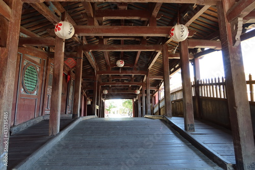 Hoi An, Vietnam, May 15, 2021: Wooden interior passage seen from the north entrance of the Japanese Bridge in Hoi An, Vietnam Fototapeta