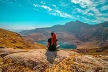 Snowdonia,Wales, UK. Girl Hiker Looking Across Beautiful Snowdon Mountain Landscape. Snowdon Mountain Landscape Is Located  In Snowdonia National Park,Wales, United Kingdom.