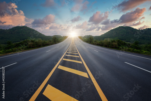 Highway, The road among the trees and mountains and ahead to success in the asphalt near the sunset, Concept road to success