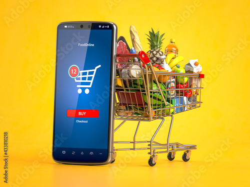 Shopping cart full of  food and smartphone. Grocery market shop, food and eats online ordering, buying and delivery concept. - fototapety na wymiar