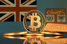 Physical Version Of Bitcoin, Gold Bar And Fiji Flag.