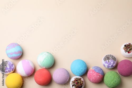 Billede på lærred Colorful bath bombs on light background, flat lay. Space for text