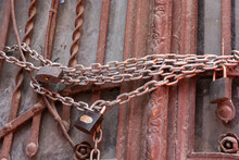 Closeup Shot Of A Door Closed By Chain And Lock