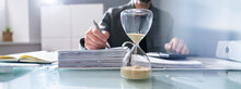 Hourglass In Office. Crunch Time