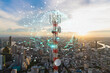 Leinwandbild Motiv Telecommunication tower with 5G cellular network antenna on city background, Global connection and internet network concept