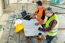 Adult Construction Workers Working On Housing Plan While At Construction Site
