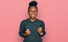 Young African American Woman Wearing Casual Clothes Excited For Success With Arms Raised And Eyes Closed Celebrating Victory Smiling. Winner Concept.