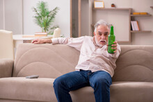 Old Man Drinking Alcohol At Home