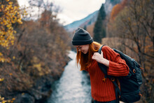 Cheerful Woman Hiker On The Bridge Near The River Mountains Travel Nature