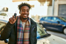 Young African American Man Smiling Happy Holding Key Car At The City