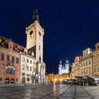 The old town square of Prague, Czech Republic, during dusk without people surrounded by the historical, gothic style buildings and the famous Tyn Church. Stroll around Prague's old town Romantic night
