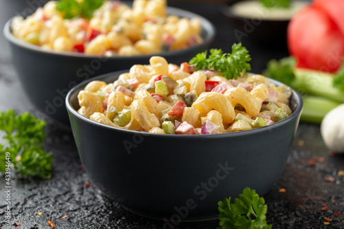 Fototapeta Macaroni Salad with red bell pepper, onion, celery, gherkins and mayonnaise dressing obraz