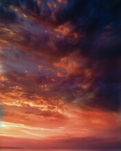 Hot Evening Sunset Sky With Black And Red Clouds Background.
