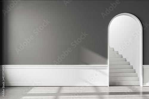 Grey empty living room with arch door, concrete floor and mockup