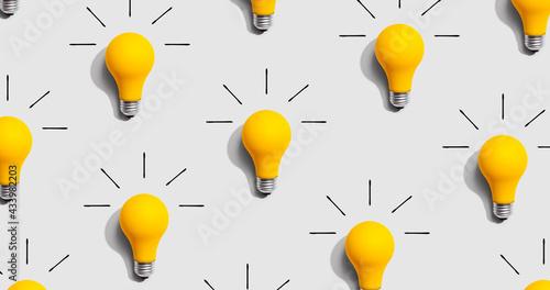 Fotografija Yellow light bulb pattern with shadow