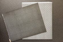 Patterned Grey End Papers Isolated On A Grey Mat Board