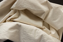 Warm Ivory Yellow Cotton Blend Fabric - Photographed From Above With Low Or Raking Light - Emphasis On Texture And Folds