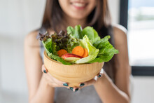 Eat High Fiber And Low Calories Foods For Good Health.Young Woman Eating Bowl Of Fresh Salad And Pure Water In The Morning.