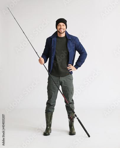 Obraz na plátně Man with fishing rod on white background