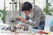 Leinwandbild Motiv Young student using a 3D printer
