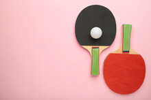 Ping Pong Rackets And Ball On Pink Background With Copy Space.