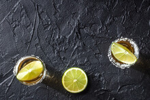 Tequila And Limes, Top Shot On A Dark Background With Copy Space