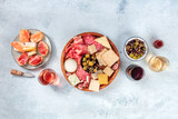Fototapeta Kawa jest smaczna - Charcuterie and cheese board, overhead flat lay shot with copy space. Italian antipasti, shot from above with wine, olives, and sanwiches. Mediterranean delicatessen