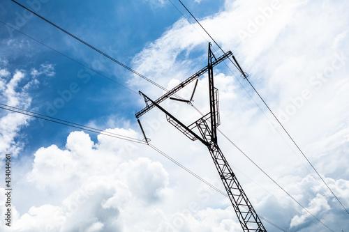 Fotografie, Obraz electricity transmission pylon silhouetted against blue sky