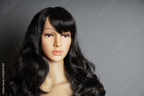 Photo shop window mannequin or display dummy head with brunette wig and naturalistic f