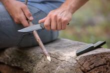 Closeup Of A Man Preparing A Wood Sculpture