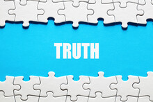 The Word Truth Framed By Jigsaw Puzzle Pieces. To Discover Or Expose The Truth, Facts And Reality