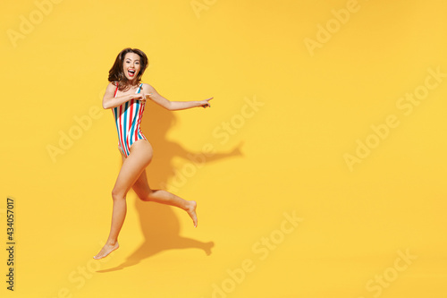 Full length fun happy young sexy woman slim body wear striped red blue one-piece Fototapet