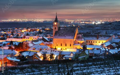Fotografie, Obraz Small town in Slovakia - Svaty Jur at night in winter